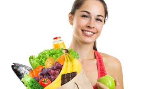Young-woman-holding-grocery-bag-of-healthy-foods-550x300